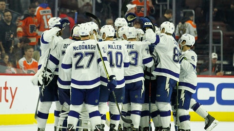 <p>               The Tampa Bay Lightning celebrate their overtime win in an NHL hockey game against the Philadelphia Flyers, Saturday, Nov. 17, 2018, in Philadelphia. The Lightning won 6-5. (AP Photo/Tom Mihalek)             </p>