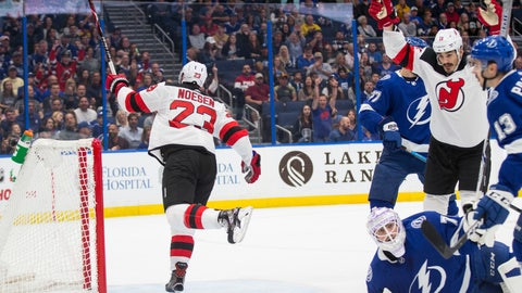 <p>               New Jersey Devils right wing Stefan Noesen (23) and center Brian Boyle celebrate a goal on Tampa Bay Lightning goaltender Louis Domingue (70) laying on the ice during the first period of an NHL hockey game, Sunday, Nov. 25, 2018, in Tampa, Fla. (AP Photo/Willie J. Allen Jr.)             </p>