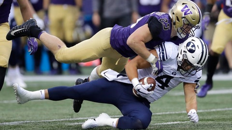 <p>               FILE - In this Sept. 29, 2018, file photo, Washington linebacker Ben Burr-Kirven (25) tackles Brigham Young running back Lopini Katoa (4) during the first half of an NCAA college football game, in Seattle. Burr-Kirven is No. 2 in the country in tackles heading into Friday's Apple Cup against No. 7 Washington State. (AP Photo/Ted S. Warren, File)             </p>