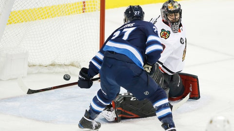 <p>               Winnipeg Jets' Nikolaj Ehlers (27) scores on Chicago Blackhawks goaltender Corey Crawford (50) during the first period of an NHL hockey game Thursday, Nov. 29, 2018, in Winnipeg, Manitoba. (John Woods/The Canadian Press via AP)             </p>