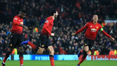<p>               ManU midfielder Marouane Fellaini, center, celebrates after scoring the opening goal during the Champions League group H soccer match between Manchester United and Young Boys at Old Trafford Stadium in Manchester, England, Tuesday Nov. 27, 2018. (AP Photo/Jon Super)             </p>