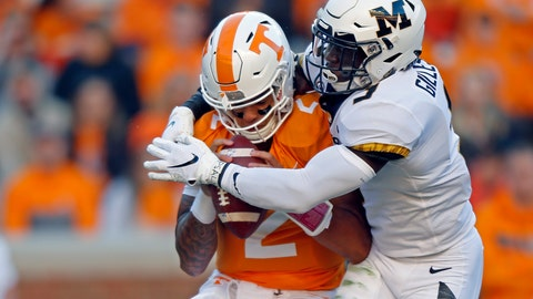<p>               Tennessee quarterback Jarrett Guarantano (2) is sacked by Missouri safety Tyree Gillespie (9) in the first half of an NCAA college football game Saturday, Nov. 17, 2018, in Knoxville, Tenn. (AP Photo/Wade Payne)             </p>