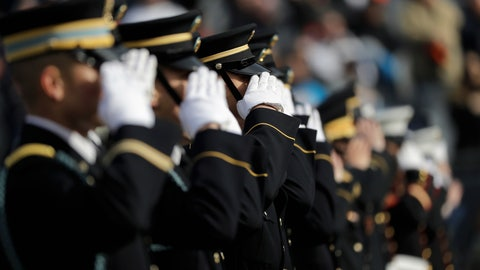 <p>               Military personnel salute during pregame ceremonies before an NFL football game between the Chicago Bears and Detroit Lions Sunday, Nov. 11, 2018, in Chicago. (AP Photo/Nam Y. Huh)             </p>