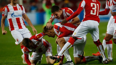 <p>               Red Star's Milan Pavkov, center, celebrates after scoring the opening goal of his team with his teammates during the Champions League group C soccer match between Red Star and Liverpool at Rajko Mitic stadium in Belgrade, Tuesday, Nov. 6, 2018. (AP Photo/Darko Vojinovic)             </p>