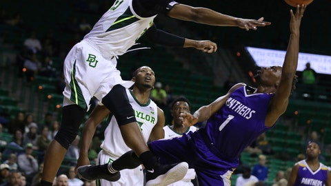 <p>               Prairie View A&M guard Taishaun Johnson, right, is pressured by Baylor forward Freddie Gillespie, left, in the first half of an NCAA college basketball game, Monday, Nov. 12, 2018, in Waco, Texas. (Rod Aydelotte/Waco Tribune Herald, via AP)             </p>