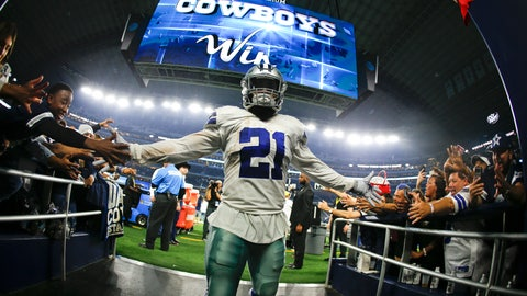 <p>               Dallas Cowboys running back Ezekiel Elliott greets fans as he comes off the field following the Cowboys' 31-23 win over the Washington Redskins in an NFL football game in Arlington, Texas, Thursday, Nov. 22, 2018. (AP Photo/Ron Jenkins)             </p>