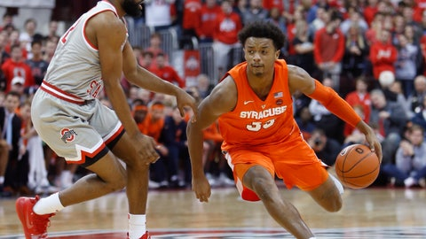 <p>               Syracuse's Elijah Hughes, right, drives to the basket against Ohio State's Keyshawn Woods during the first half of an NCAA college basketball game Wednesday, Nov. 28, 2018, in Columbus, Ohio. (AP Photo/Jay LaPrete)             </p>