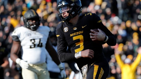 <p>               Missouri quarterback Drew Lock scores on a 3-yard touchdown run during the second half of an NCAA college football game against Vanderbilt Saturday, Nov. 10, 2018, in Columbia, Mo. Missouri won 33-28. (AP Photo/Jeff Roberson)             </p>