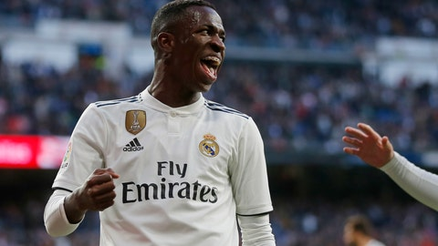 <p>               Real Madrid's Vinicius Junior celebrates after scoring his side's 1st goal during a Spanish La Liga soccer match between Real Madrid and Valladolid at the Santiago Bernabeu stadium in Madrid, Spain, Saturday, Nov. 3, 2018. (AP Photo/Paul White)             </p>
