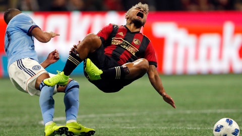 <p>               Atlanta United forward Josef Martine, right, collides with New York City FC midfielder Yangel Herrera, left, during the first half of an MLS playoff soccer match Sunday, Nov. 11, 2018, in Atlanta. (AP Photo/John Bazemore)             </p>