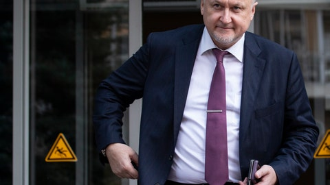 <p>               FILE - In this file photo taken on Thursday, Sept. 20, 2018, Russian National Anti-doping Agency RUSADA head Yuri Ganus leaves the office in Moscow, Russia. The head of the Russian anti-doping agency, known as RUSADA, urged the government to cooperate with WADA, saying that time was running out to avoid new, heavier sanctions for non-cooperation. (AP Photo/Alexander Zemlianichenko, File)             </p>