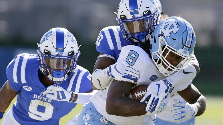 Duke holds off rival UNC 42-35 to keep Victory Bell