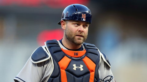 <p>               FILE- In this April 10, 2018, file photo, Houston Astros catcher Brian McCann watches in the first inning of a baseball game against the Minnesota Twins  in Minneapolis. A person familiar with the negotiations tells The Associated Press that McCann has agreed to return to the Atlanta Braves for a $2 million, one-year contract. The person spoke on condition of anonymity Monday, Nov. 26, 2018, because the agreement had not yet been announced. (AP Photo/Jim Mone, File)             </p>