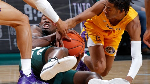 <p>               Michigan State's Joshua Langford, left, and Tennessee Tech's Jr. Clay wrestle for the ball during the first half of an NCAA college basketball game Sunday, Nov. 18, 2018, in East Lansing, Mich. (AP Photo/Al Goldis)             </p>