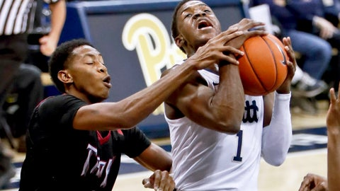 <p>               Troy's Javan Johnson, left, grabs Pittsburgh's Xavier Johnson as he shoots during the first half of an NCAA college basketball game, Monday, Nov. 12, 2018, in Pittsburgh. (AP Photo/Keith Srakocic)             </p>