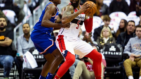 <p>               Washington Wizards forward Markieff Morris (5) dribbles past New York Knicks guard Frank Ntilikina (11) during the first half of an NBA basketball game, Sunday, Nov. 4, 2018, in Washington. (AP Photo/Al Drago)             </p>