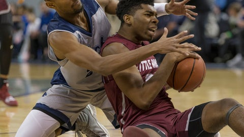 <p>               Nevada forward Jordan Brown, left, and Little Rock forward Kamani Johnson scramble for a loose ball during the first half of an NCAA college basketball game in Reno, Nev., Friday, Nov. 16, 2018. (AP Photo/Tom R. Smedes)             </p>