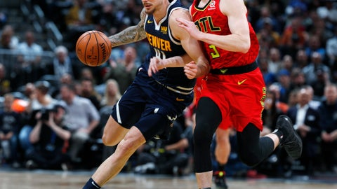 <p>               Denver Nuggets forward Juan Hernangomez, left, drives to the rim past Atlanta Hawks guard Kevin Huerter in the second half of an NBA basketball game Thursday, Nov. 15, 2018, in Denver. The Nuggets won 138-93. (AP Photo/David Zalubowski)             </p>