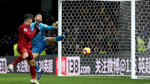 <p>               Watford goalkeeper Ben Foster fails to make a save as Liverpool's Roberto Firmino scores his side's third goal of the game during their English Premier League soccer match against Watford at Vicarage Road, Watford, England, Saturday, Nov. 24, 2018. (Chris Radburn/PA via AP)             </p>
