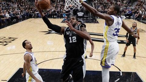 <p>               San Antonio Spurs forward LaMarcus Aldridge (12) scores past Golden State Warriors forward Kevin Durant (35) during the second half of an NBA basketball game, Sunday, Nov. 18, 2018, in San Antonio. San Antonio won 104-92. (AP Photo/Eric Gay)             </p>