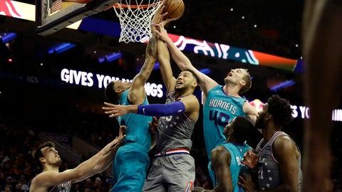 <p>               Philadelphia 76ers' Ben Simmons, center, tries to get a shot past Charlotte Hornets' Miles Bridges, left, and Cody Zeller during the second half of an NBA basketball game, Friday, Nov. 9, 2018, in Philadelphia. Philadelphia won 133-132 in overtime. (AP Photo/Matt Slocum)             </p>