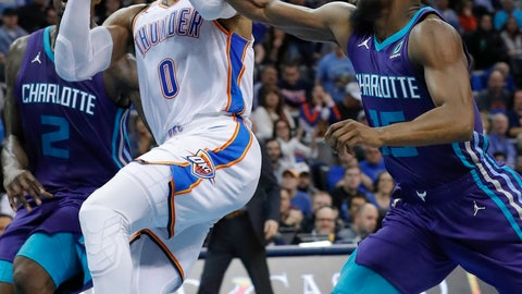 <p>               Oklahoma City Thunder guard Russell Westbrook (0) is fouled on the way to the basket by Charlotte Hornets guard Kemba Walker (15) during the second half of an NBA basketball game in Oklahoma City, Friday, Nov. 23, 2018. Oklahoma City won 109-104. (AP Photo/Alonzo Adams)             </p>
