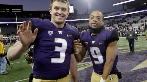 <p>               Washington tailback Myles Gaskin (9) gets quarterback Jake Browning to wave to a photographer after an NCAA college football game against Oregon State, Saturday, Nov. 17, 2018, in Seattle. (AP Photo/Elaine Thompson)             </p>