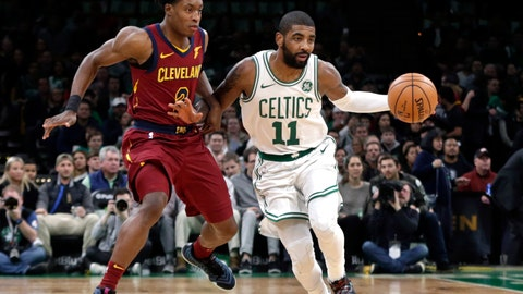<p>               Boston Celtics guard Kyrie Irving (11) advances the ball downcourt against Cleveland Cavaliers guard Collin Sexton (2) during the first half of an NBA basketball game Friday, Nov. 30, 2018, in Boston. (AP Photo/Elise Amendola)             </p>