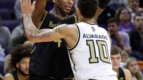 <p>               Northwestern forward Vic Law, left, looks to pass against Georgia Tech guard Jose Alvarado during the second half of an NCAA college basketball game, Wednesday, Nov. 28, 2018, in Evanston, Ill. Northwestern won 67-61. (AP Photo/Nam Y. Huh)             </p>