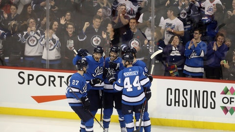 <p>               Winnipeg Jets' Nikolaj Ehlers (27), Blake Wheeler (26), Mark Scheifele (55), Josh Morrissey (44) and Jacob Trouba (8) celebrate after Scheifele scored against the New Jersey Devils during first period NHL hockey action in Winnipeg, Sunday, Nov. 11, 2018. (Trevor Hagan/The Canadian Press via AP)             </p>