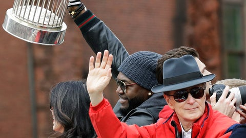 <p>               Boston Red Sox owner John Henry waves as David Ortiz holds one of the team's four World Series trophies during a parade to celebrate the team's World Series championship over the Los Angeles Dodgers, Wednesday, Oct. 31, 2018, in Boston. (AP Photo/Elise Amendola)             </p>