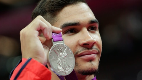 <p>               FILE - In this Sunday, Aug. 5, 2012 file photo, Britain's gymnast Louis Smith displays his silver medal after the artistic gymnastics men's pommel horse finals at the 2012 Summer Olympics, in London. Louis Smith, who ended Britain's 80-year medal drought in gymnastics at the Olympics, has retired from competing. (AP Photo/Julie Jacobson, File)             </p>