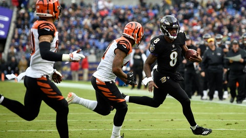 <p>               Baltimore Ravens quarterback Lamar Jackson (8) rushes the ball against Cincinnati Bengals defensive back Darqueze Dennard, center, and free safety Jessie Bates in the first half of an NFL football game, Sunday, Nov. 18, 2018, in Baltimore. (AP Photo/Nick Wass)             </p>