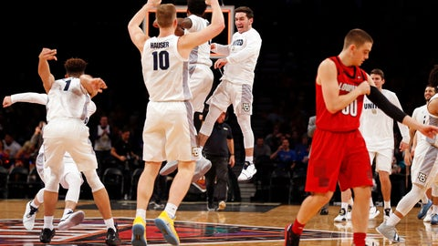 <p>               Marquette Sam Hauser (10) celebrates with teammates as Louisville guard Ryan McMahon (30) walks off the court after an NCAA college basketball game in the NIT Season Tip-Off tournament Friday, Nov. 23, 2018, in New York. Marquette won 77-74 in overtime. (AP Photo/Adam Hunger)             </p>