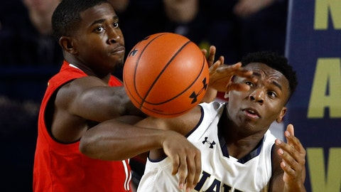 <p>               Maryland guard Darryl Morsell, left, and Navy guard Hasan Abdullah chase after a rebound in the first half of an NCAA college basketball game at the Veterans Classic tournament in Annapolis, Md., Friday, Nov. 9, 2018. (AP Photo/Patrick Semansky)             </p>