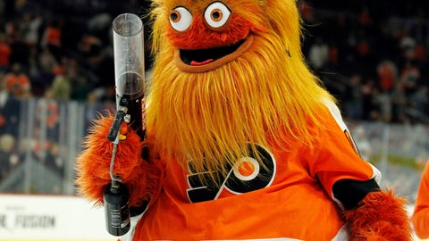 <p>               FILE - In this Sept. 24, 2018, file photo, the Philadelphia Flyers new mascot, Gritty, takes to the ice during the first intermission of the Flyers' preseason NHL hockey game against the Boston Bruins in Philadelphia. What better way to surprise a Philadelphia wedding party than with Gritty? CBS Philly reports newlyweds were shocked when the buck-eyed, 7-foot mascot for the NHL's Flyers showed up Friday night, Nov. 23, 2018, and started dancing to laughs and applause. (AP Photo/Tom Mihalek, File)             </p>