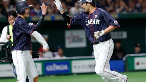 <p>               All Japan's designated hitter Yuki Yanagita, right, celebrates with teammate Sosuke Genda after hitting a two-run home-run off MLB All-Star starter Erasmo Ramirez of the Seattle Marinersin the third inning of Game 2 of their All-Stars Series baseball at Tokyo Dome in Tokyo, Saturday, Nov. 10, 2018. (AP Photo/Toru Takahashi)             </p>