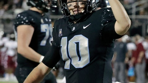<p>               Central Florida quarterback McKenzie Milton celebrates after his 1-yard touchdown run against Temple during the first half of an NCAA college football game, Thursday, Nov. 1, 2018, in Orlando, Fla. (AP Photo/John Raoux)             </p>
