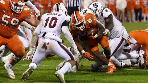 <p>               Clemson's Travis Etienne scores a touchdown while defended by South Carolina's R.J. Roderick during the second half of an NCAA college football game Saturday, Nov. 24, 2018, in Clemson, S.C. Clemson won 56-35. (AP Photo/Richard Shiro)             </p>