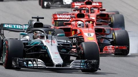 <p>               Mercedes driver Lewis Hamilton, of Britain, steers his car chased by Ferrari driver Sebastian Vettel, of Germany, during Brazilian Formula One Grand Prix at the Interlagos race track in Sao Paulo, Brazil, Sunday, Nov. 11, 2018. (AP Photo/Andre Penner)             </p>