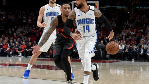 <p>               Orlando Magic guard D.J. Augustin, right, passes the ball behind his back to guard Evan Fournier, back left, as Portland Trail Blazers guard Damian Lillard, center, defends during the first half of an NBA basketball game in Portland, Ore., Wednesday, Nov. 28, 2018. (AP Photo/Steve Dykes)             </p>