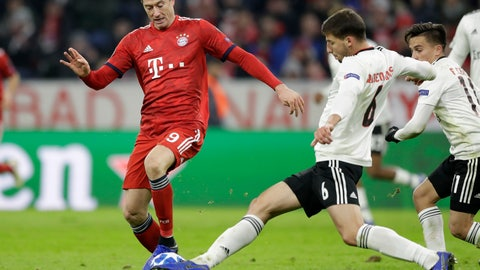 <p>               Bayern forward Robert Lewandowski, left, and Benfica's Ruben Dias challenge for the ball during the Champions League group E soccer match between FC Bayern Munich and Benfica Lisbon in Munich, Germany, Tuesday, Nov. 27, 2018. (AP Photo/Matthias Schrader)             </p>