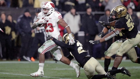 <p>               FILE - In this Saturday, Nov. 17, 2018, file photo, Wisconsin running back Jonathan Taylor (23) breaks the tackle of Purdue safety Navon Mosley (27) on his way to scoring a game-winning touchdown during overtime of an NCAA college football game in West Lafayette, Ind. The sophomore is a finalist for a second straight year for the Doak Walker Award, given to the nation's best running back. He's 131 yards short of his first 2,000-yard season as the Badgers get ready to play Minnesota this weekend in the annual rivalry game for Paul Bunyan's Axe. (AP Photo/Michael Conroy, File)             </p>
