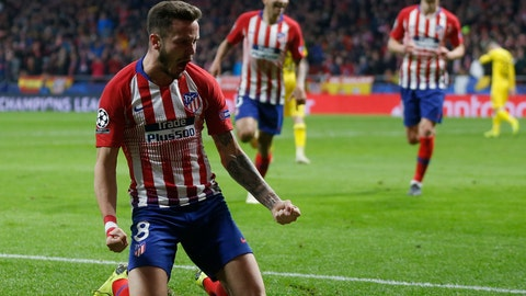 <p>               Atletico Saul Niguez celebrates after scoring his side's opening goal during the Group A Champions League soccer match between Atletico Madrid and Borussia Dortmund at Wanda Metropolitano stadium in Madrid, Spain, Tuesday, Nov. 6, 2018. (AP Photo/Paul White)             </p>