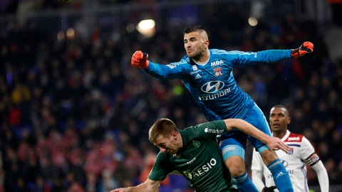 <p>               Lyon's goalkeeper Anthony Lopes, top, makes a save in front of Saint-Etienne's Robert Beric, left, during the French League One soccer match between Lyon and Saint-Etienne at the Stade de Lyon near Lyon, France, Friday, Nov. 23, 2018. (AP Photo/Laurent Cipriani)             </p>