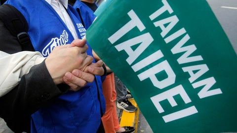 "<p>               In this Nov. 3, 2018, photo, supporters hold hands and a flag with the words ""Taiwan Taipei"" during a rally for a referendum asking if national teams, including ones for the Olympics, should go by the name ""Taiwan Taipei"" instead of ""Chinese Taipei"" in Taipei, Taiwan. Taiwan will vote on a referendum this month asking if the self-ruled island should compete as ""Taiwan"" instead of the present ""Chinese Taipei."" This would include the 2020 Olympics in Tokyo. The controversial referendum has angered China, which sees Taiwan as a breakaway province. (AP Photo/Chiang Ying-ying)             </p>"