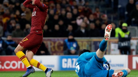 <p>               Roma forward Cengiz Under reacts past Real goalkeeper Thibaut Courtois during a Champions League, Group G soccer match between Roma and Real Madrid at the Rome Olympic stadium, Tuesday, Nov. 27, 2018. (AP Photo/Gregorio Borgia)             </p>