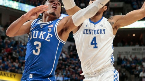 <p>               Duke guard Tre Jones (3) next to Kentucky forward Nick Richards (4) during the first half of an NCAA college basketball game at the Champions Classic in Indianapolis on Tuesday, Nov. 6, 2018. (AP Photo/AJ Mast)             </p>