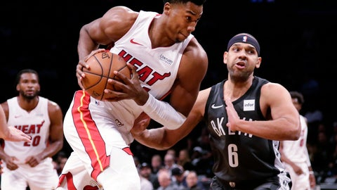 <p>               Miami Heat's Hassan Whiteside (21) drives past Brooklyn Nets' Jared Dudley (6) during the first half of an NBA basketball game Wednesday, Nov. 14, 2018, in New York. (AP Photo/Frank Franklin II)             </p>