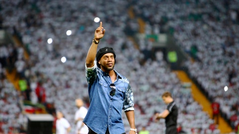 <p>               FILE - In this file photo dated Sunday, July 16, 2017, Brazilian soccer star and former FC Barcelona player Ronaldinho greets fans at the stadium in Grozny, Russia. Brazilian Prosecutors said Thursday Nov. 22, 2018, that they have seized three luxury cars and a painting that belonged to Ronaldinho's brother-agent Roberto de Assis, in connection with an alleged environmental case against the Ronaldinho Institute in the southern Brazilian city of Porto Alegre. (AP Photo/Musa Sadulayev, FILE)             </p>